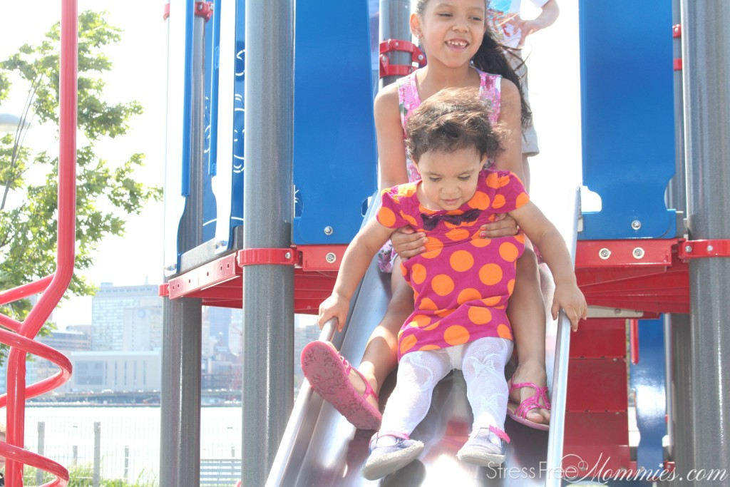 girls on slide in the park