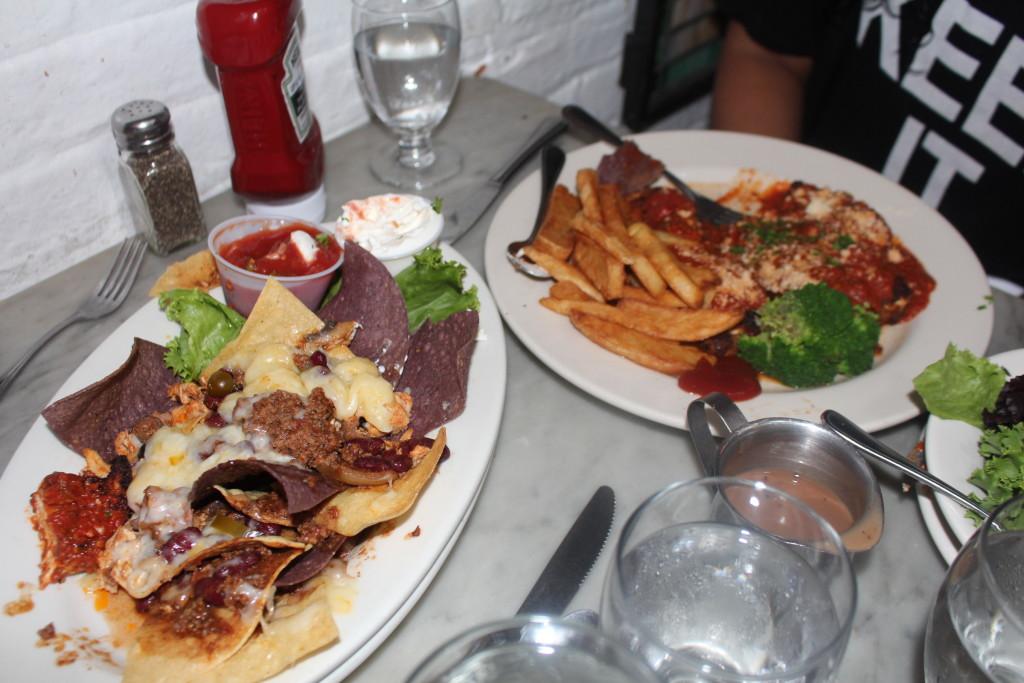 chicken nachos and chicken parmesan with fries