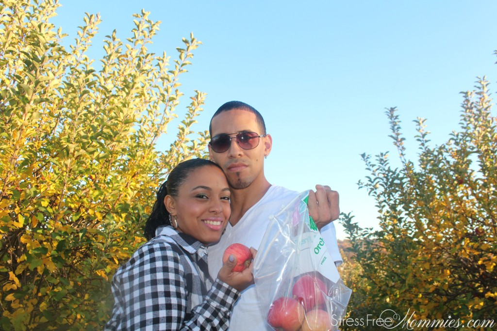 wife and husband apple picking