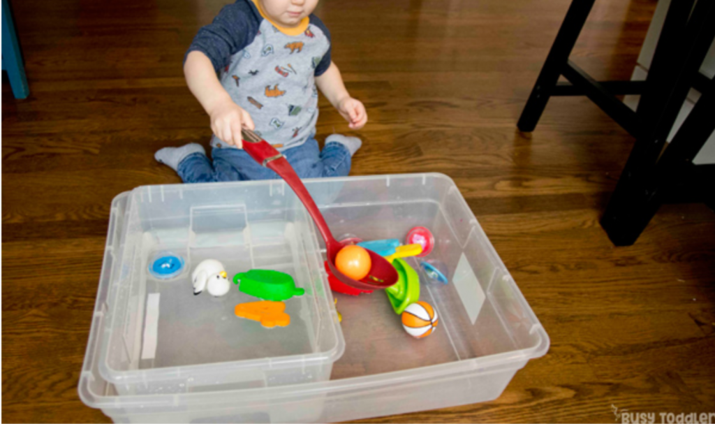 scoop and pour toddler activity